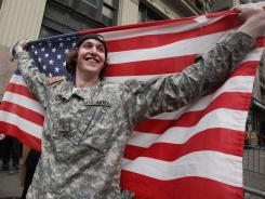 Kevin Van Orden, whose brother is in the U.S. Army, celebrates outside the World Trade Center site on Monday.