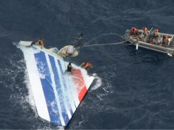 Brazil's Navy sailors recover debris from the missing Air France Flight 447 in the Atlantic Ocean.