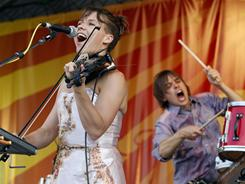 Arcade Fire performs at the New Orleans Jazz and Heritage Festival on Friday.