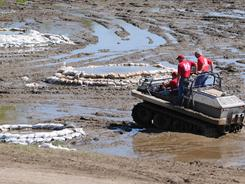 Army Corps of Engineers personnel check sand boils in agricultural fields along the levee system in Fulton County near Hickman, Ky., on Friday.