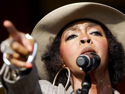 Lauryn Hill performs at the New Orleans Jazz and Heritage Festival on Saturday.