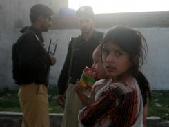 A Pakistani girl stands near the compound of al-Qaida leader Osama bin Laden, in Abbottabad, Pakistan, on Saturday.