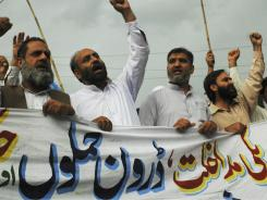 Supporters of the Pakistani religious party Jamaat-e-Islami rally to condemn the killing of al-Qaida leader Osama bin Laden in Rawalpindi, Pakistan on Friday.