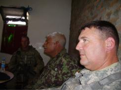 Lt. Col. Jeff Smiley, Afghan 201st Corps Commander Maj. Gen. Abdullah, and 101st Airborne Deputy Commander Brig. Gen. Warren Phipps listen as a local Afghan National Army commander expresses the needs of his troops at a remote combat outpost in the Pesh River Valley.