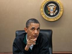 President Obama makes a point about the mission against Osama bin Laden during a national security meeting.