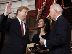 Vice President Joe Biden swears in Sen. Dean Heller, R-Nev., as his wife,  Lynne, witnesses.