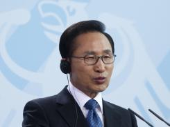 South Korean President Lee Myung Bak briefs the media Monday after a meeting with German Chancellor Angela Merkel at the chancellery in Berlin.