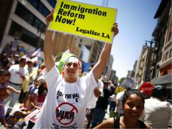 Demonstrators urge changes to immigration law May 1 in Los Angeles.
