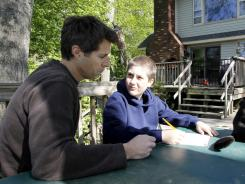 David Goldman and his 10-year-old son, Sean Goldman, go over the fifth-grader's math homework at their home in Tinton Falls, N.J. Goldman became the poster dad for the issue of international child abductions when his ex-wife ran off to Brazil with Sean and didn't come back. He finally got custody of his son in 2009.