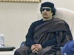In this image made from Libyan TV, Libyan leader Moammar Gadhafi holds a meeting Wednesday with tribal leaders  in Tripoli, Libya.