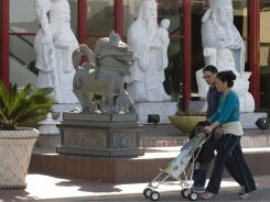 Shoppers enter the Asian Garden Mall in Westminster, Calif., on March 8.  Surging Latino and Asian populations accounted for virtually all of California's population growth over the last decade, Census data show.