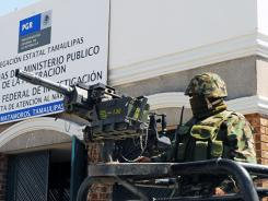 Members of the Mexican Army guard the Matamoros police station on April 26 in northern Mexico.