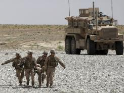 A Marine wounded by an IED is carried to a medevac helicopter on May 8 in Afghanistan.