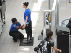 A passenger is patted down by a TSA agent May 2 at Orlando International Airport. Security in airports and train stations has been increased since the death of Osama bin Laden.