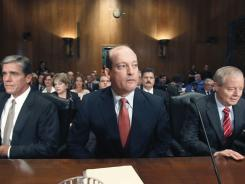 Oil company executives, from left,  Shell Oil President Marvin Odum, BP America Chairman H. Lamar McKay and ConocoPhillips CEO James Mulva, arrive on Capitol Hill in Washington on Thursday to testify before the Senate Finance Committee.