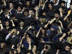 Just graduated: Students turn tassels after receiving their degrees at University of Connecticut in Storrs on May 8.