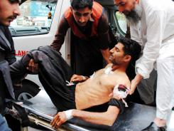 An injured man is taken to a hospital in Peshawar, Pakistan.