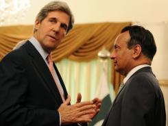 Sen. John Kerry speaks with Pakistan ambassador to the United States Hussain Haqqani prior to a meeting with Pakistani Prime Minister Yousuf Raza Gilani on Monday.