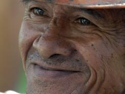 Miner Uriel Angel Villegas, 58, smiles after being rescued from the Loma Gorda caved-in coal mine in Montebello, southern Colombia.