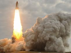Space shuttle Endeavour lifts off from Kennedy Space Center on Monday.