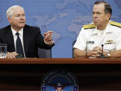 Secretary Robert Gates, left, and Adm. Michael Mullen, Joint Chiefs of Staff chairman, discuss Pakistan on Wednesday.
