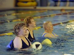 Doris Rye, Eileen De Jong and Dee Chapman participate in a water aerobics class in