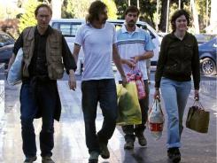 From left, freed journalists Nigel Chandler, Manu Brabo, James Foley and Clare Morgana Gillis arrive at Rixos Hotel in the Libyan capital Tripoli on Wednesday after their release.