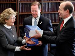 Rep. Diane Black, R-Tenn., weighs the president's budget with lawmakers Scott Garrett, R-N.J., right, and Bill Flores, R-Texas.