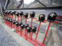 Mine helmets and painted crosses sit at the entrance to Massey Energy's Upper Big Branch coal mine on April 5 in Montcoal, W.Va.