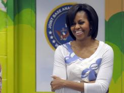 First lady Michelle Obama waits to speak at an event at Joint Base Anacostia-Bolling in Washington on Thursday. First Lady Michelle Obama will address roughly 1,000 graduating cadets and their families at West Point's annual graduation family banquet .