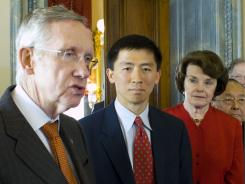 Majority Leader Harry Reid, D-Nev., stands with judicial nominee Goodwin Liu, and Sens. Diane Feinstein, D-Calif., and Daniel Inouye, D-Hawaii., on Capitol Hill in Washington.