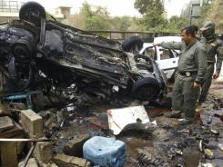 Iraqi security forces inspect the scene of a bombing in Kirkuk, 180 miles north of Baghdad.