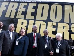 "Congressman John Lewis, left, speaks along with other freedom riders during the premiere of ""Freedom Riders"" to celebrate the 50th anniversary of the original Freedom Rides at The Newseum on May 6 in Washington."