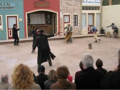 Actors re-enact the O.K. Corral shootout in Tombstone, Ariz.