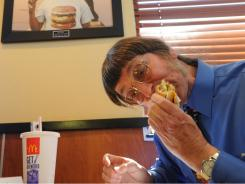 Don Gorske, 59, a retired prison guard, eats his 25,000th Big Mac on Tuesday at a McDonalds in his hometown of Fond du La, Wis.