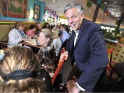 Jon Huntsman talks with diners at Shorty's Mexican Roadhouse in Manchester, N.H.
