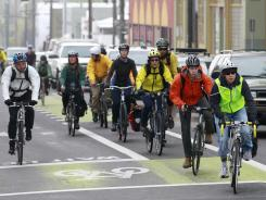 Cyclists travel in Portland, Ore. An increasing number of states have passed legislation to make biking safer.