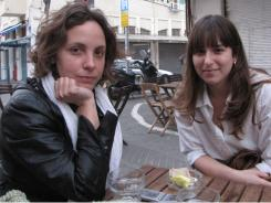 Kindergarten teacher Liat Ben Yaacov, left, with friend Vered Kraus at an outdoor cafe in Jaffa, says populist revolutions sweeping the Arab world frighten her.