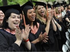 Public Health graduates celebrate during commencement at Yale University in New Haven, Conn.