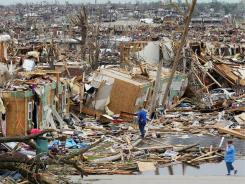 Shock and grief grip a Missouri city struck by one of the deadliest twisters in nearly 60 years.