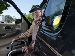 Norman Pondick displays the Yellow Dot sticker on his vehicle's left rear window. The sticker alerted first responders to Pondick's information in the glove box.
