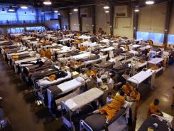 Several hundred inmates crowd the gymnasium at San Quentin prison in San Quentin, Calif.