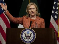 U.S. Secretary of State Hillary Rodham Clinton addresses a news conference with Adm. Mike Mullen, the chairman of the U.S. Joint Chiefs of Staff, at the U. S. Embassy in Islamabad, Pakistan, on Friday.