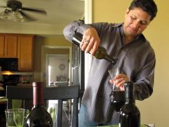 Jose Placencia pours wine on May 26 at his home in Squaw Valley, Calif. Placencia, a first generation Mexican-American, was turned on to wine when he attended college.
