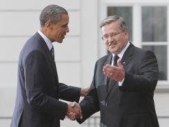 President Obama shakes hands with his Polish counterpart, Bronislaw Komorowski, Friday at the Presidential Palace in Warsaw.