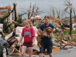 Joplin residents head to a rescue center after their home was destroyed by a tornado that hit the southwest Missouri city.