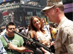 A Marine shows weaponry during Friday's demonstrations in Times Square as part of Fleet Week festivities in New York City.
