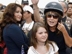 "Former Alaska governor Sarah Palin and her daughter Piper, center, prepare to participate in the ""Rolling Thunder"" rally on Sunday in Arlington, Virginia."