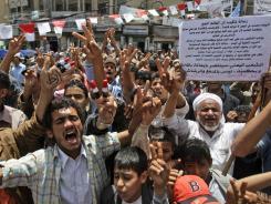 Anti-government protesters demand the resignation of Yemeni President Ali Abdullah Saleh in Sanaa, Yemen, on Sunday.