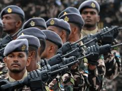 Sri Lankan Airforce soldiers march during the Victory Day parade in Colombo on May 27.  Sri Lankan President Mahinda Rajapakse vowed to defend his military from war crimes allegations.